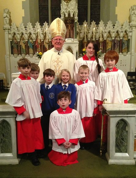 Bishop Michael with altar servers and school children